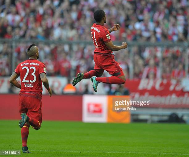 Douglas Costa and Arturo Vidal of Bayern Muenchen celebrate their side's second goal during the Bundesliga match between FC Bayern Muenchen and VfB...
