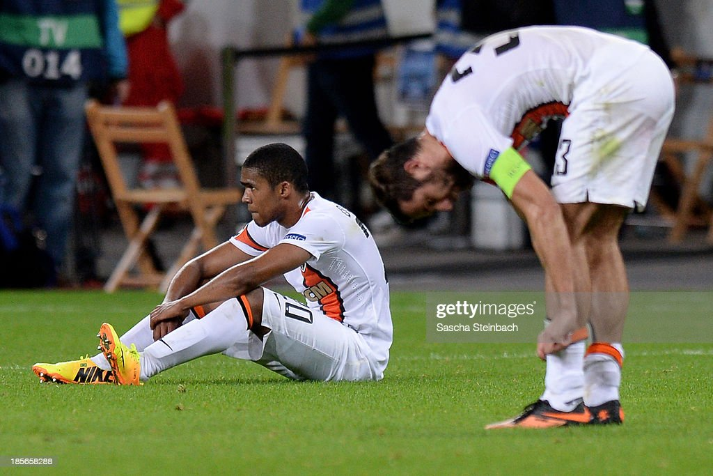 <a gi-track='captionPersonalityLinkClicked' href=/galleries/search?phrase=Douglas+Costa+-+Soccer+Forward+born+1990&family=editorial&specificpeople=5672410 ng-click='$event.stopPropagation()'>Douglas Costa</a> and <a gi-track='captionPersonalityLinkClicked' href=/galleries/search?phrase=Darijo+Srna&family=editorial&specificpeople=546578 ng-click='$event.stopPropagation()'>Darijo Srna</a> of Donetsk look dejected after loosing the UEFA Champions League Group A match between Bayer Leverkusen and Shakhtar Donetsk at BayArena on October 23, 2013 in Leverkusen, Germany.
