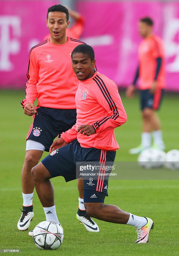 Douglas Costa and Thiago Alcantara in action during a FC Bayern Muenchen training session ahead of their UEFA Champions League semi final second leg match against Club Atletico de Madrid at the Saebener Strasse training ground on May 2, 2016 in Munich, Germany.