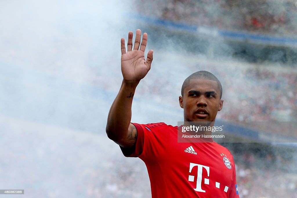 Douglas Costa arrives for the FC Bayern Muenchen season opening and team presentation at Allianz Arena on July 11 2015 in Munich Germany