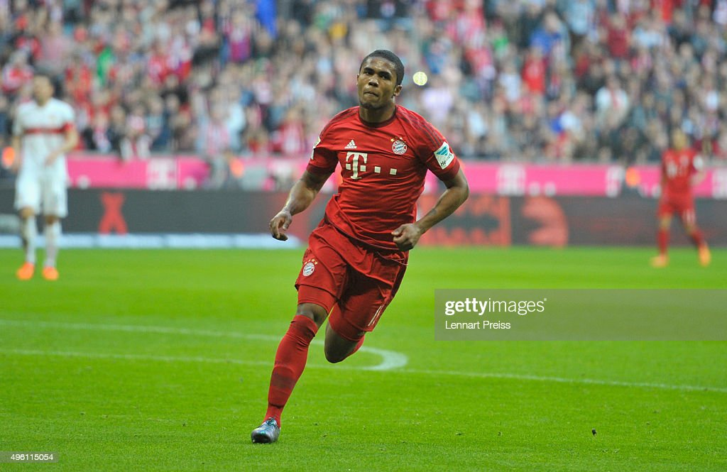 Douglas Costa celebrates his side's second goal during the Bundesliga match between FC Bayern Muenchen and VfB Stuttgart at Allianz Arena on November...