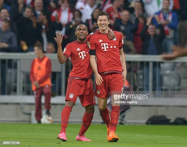 Douglas Costa de Souza and Robert Lewandowski of Bayern Munich celebrate a goal during the Bundesliga soccer match between FC Bayern Munich and VfL...