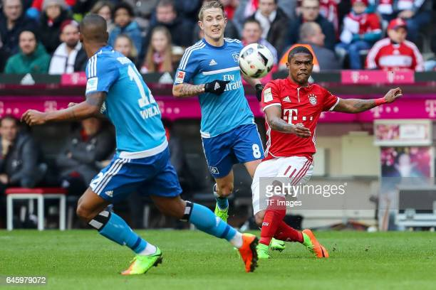 Douglas Costa de Souza of Bayern Muenchen and Walace Souza Silva of Hamburg battle for the ball during the Bundesliga match between Bayern Muenchen...