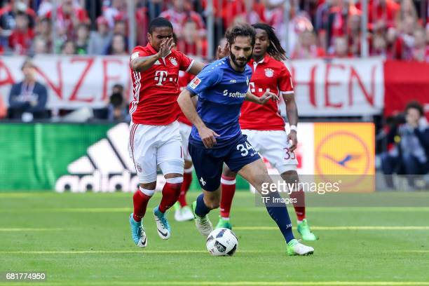 Douglas Costa de Souza of Munich and Hamit Altintop of Darmstadt battle for the ball during the Bundesliga match between Bayern Muenchen and SV...