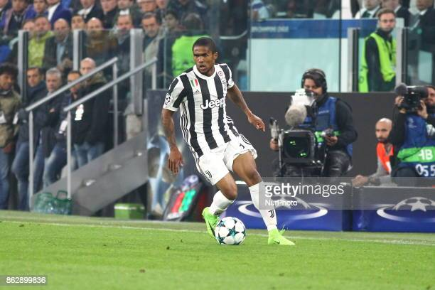 Douglas Costa in action during the UEFA Champions League football match between Juventus FC and Sporting CP at Allianz Stadium on 18 October 2017 in...