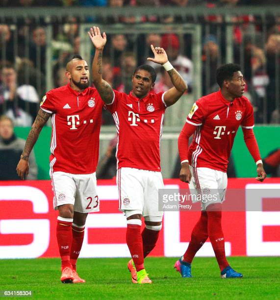 Douglas Costa of Bayern Muenchen cekebrates scoring the first goal during the DFB Cup Round Of 16 match between Bayern Muenchen and VfL Wolfsburg at...