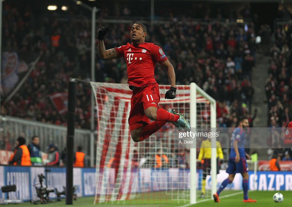 Douglas Costa of Bayern Muenchen celebrates his first goal during the Champions League group F match between FC Bayern Muenchen and Olympiacos FC on...