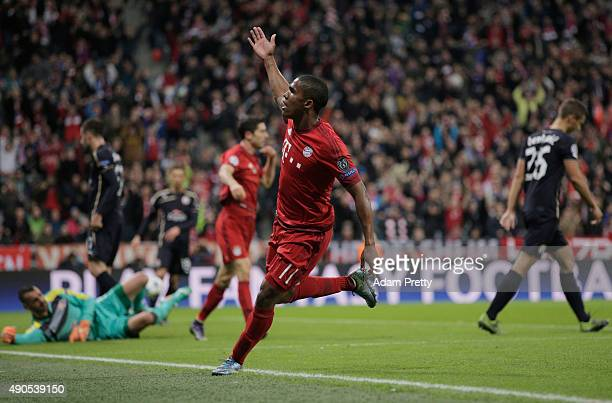Douglas Costa of Bayern Muenchen celebrates his opening goal during the UEFA Champions League Group F match between FC Bayern Munchen and GNK Dinamo...