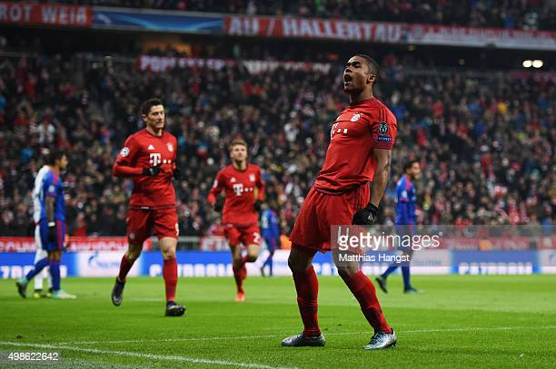 Douglas Costa of Bayern Muenchen celebrates scoring his teams opening goal during the UEFA Champions League group F match between FC Bayern Munchen...