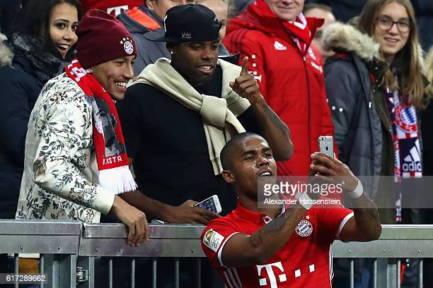 Douglas Costa of Bayern Muenchen celebrates with a selfie after he scores his team's 2nd goal during the Bundesliga match between Bayern Muenchen and...