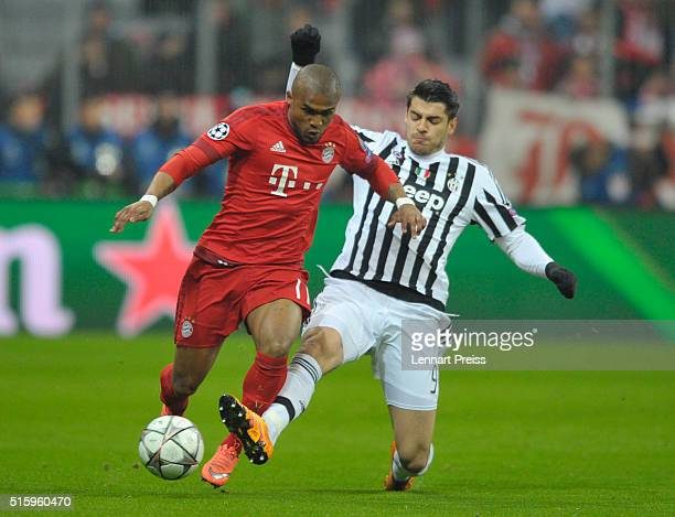 Douglas Costa of Bayern Muenchen challenges Alvaro Morata of Juventus Turin during the UEFA Champions League Round of 16 second leg match between FC...