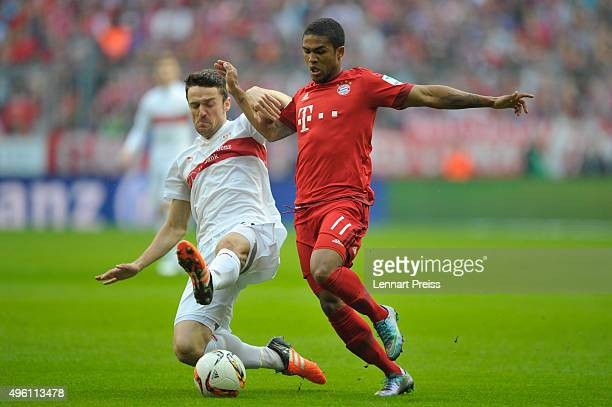 Douglas Costa of Bayern Muenchen challenges Christian Gentner of VfB Stuttgart during the Bundesliga match between FC Bayern Muenchen and VfB...