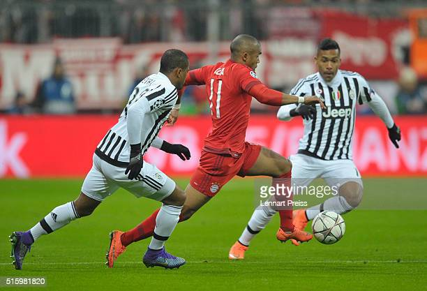 Douglas Costa of Bayern Muenchen challenges Patrice Evra and Alex Sandro of Juventus Turin during the UEFA Champions League Round of 16 second leg...