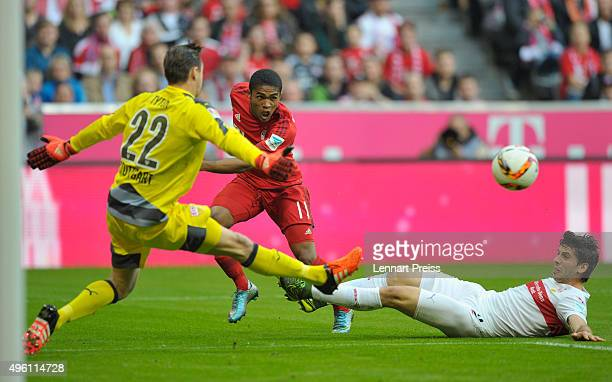 Douglas Costa of Bayern Muenchen challenges Przemyslaw Tyton and Emiliano Insua of VfB Stuttgart during the Bundesliga match between FC Bayern...