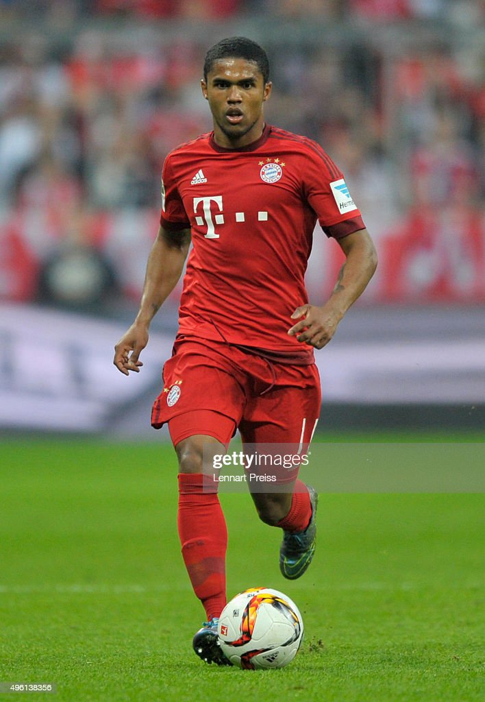 Douglas Costa of Bayern Muenchen in action during the Bundesliga match between FC Bayern Muenchen and VfB Stuttgart at Allianz Arena on November 7...