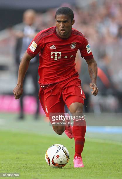 Douglas Costa of Bayern Muenchen kicks the ball during the Bundesliga match between FC Bayern Muenchen and FC Augsburg at Allianz Arena on September...