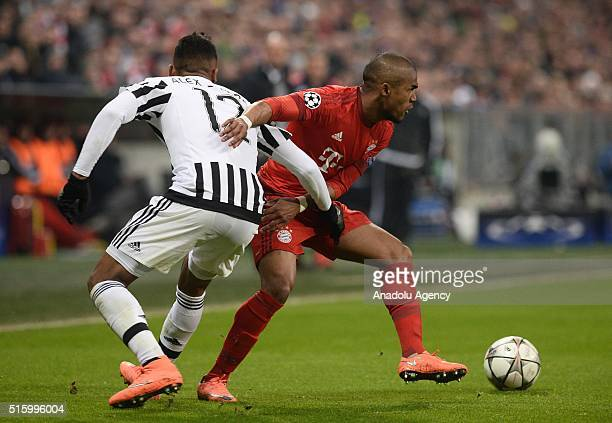 Douglas Costa of Bayern Munich and Alex Sandro of Turin vie for the ball during the UEFA Champions League round of 16 second leg soccer match between...