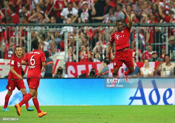 Douglas Costa of Bayern Munich celebrates as he scores their fifth goal during the Bundesliga match between FC Bayern Muenchen and Hamburger SV at...