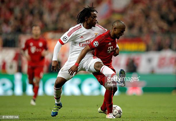 Douglas Costa of Bayern Munich holds off Renato Sanches of Benfica during the UEFA Champions League quarter final first leg match between FC Bayern...