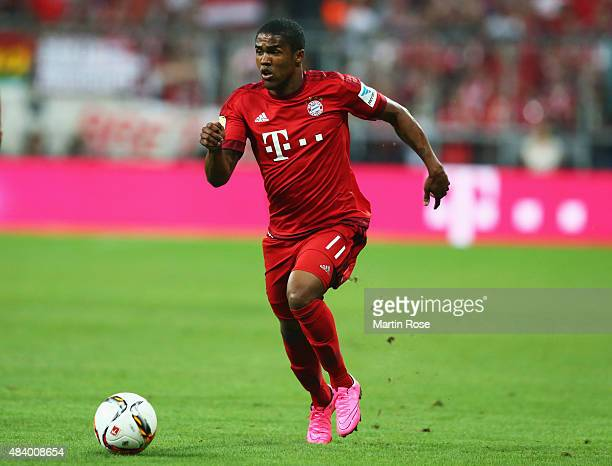 Douglas Costa of Bayern Munich runs with the ball during the Bundesliga match between FC Bayern Muenchen and Hamburger SV at Allianz Arena on August...