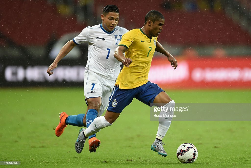 Douglas Costa of Brazil and Izaguirre of Honduras compete for the ball during the International Friendly Match between Brazil and Honduras at Beira...