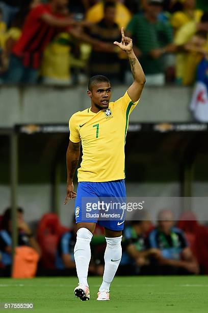 Douglas Costa of Brazil celebrates after scoring a goal during a match between Brazil and Uruguay as part of 2018 FIFA World Cup Russia Qualifiers at...