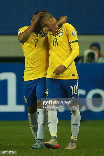 Douglas Costa of Brazil celebrates with teammate Neymar after scoring the second goal of his team during the 2015 Copa America Chile Group C match...
