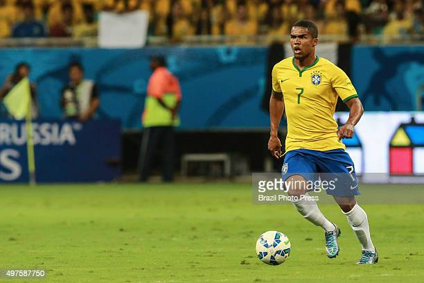 Douglas Costa of Brazil drives the ball during a match between Brazil and Peru as part of FIFA 2018 World Cup Qualifiers at Arena Fonte Nova Stadium...
