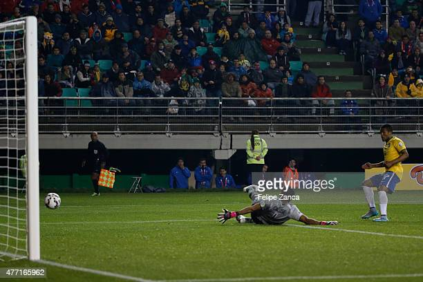 Douglas Costa of Brazil shoots to score during the 2015 Copa America Chile Group C match between Brazil and Peru at Municipal Bicentenario Germán...