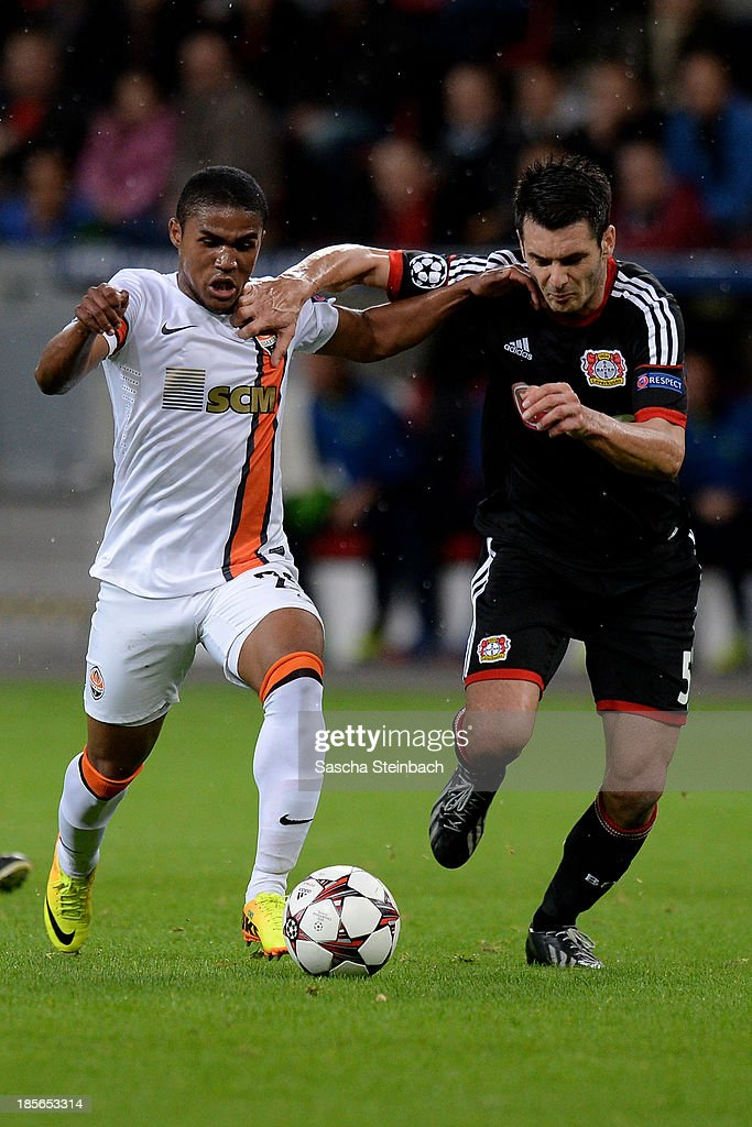 <a gi-track='captionPersonalityLinkClicked' href=/galleries/search?phrase=Douglas+Costa+-+Soccer+Forward+born+1990&family=editorial&specificpeople=5672410 ng-click='$event.stopPropagation()'>Douglas Costa</a> of Donetsk and Emir Spahic battle for the ball during the UEFA Champions League Group A match between Bayer Leverkusen and Shakhtar Donetsk at BayArena on October 23, 2013 in Leverkusen, Germany.