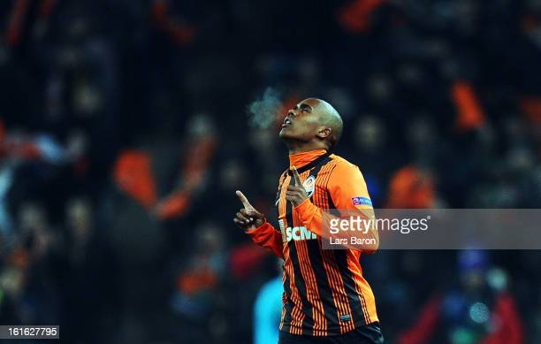 Douglas Costa of Donetsk celebrates after scoring his teams second goal during the UEFA Champions League Round of 16 first leg match between Shakhtar...