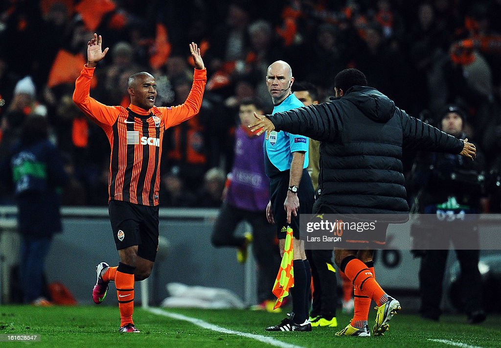 Douglas Costa of Donetsk celebrates with team mate Taison after scoring his teams second goal during the UEFA Champions League Round of 16 first leg match between Shakhtar Donetsk and Borussia Dortmund at Donbass Arena on February 13, 2013 in Donetsk, Ukraine.