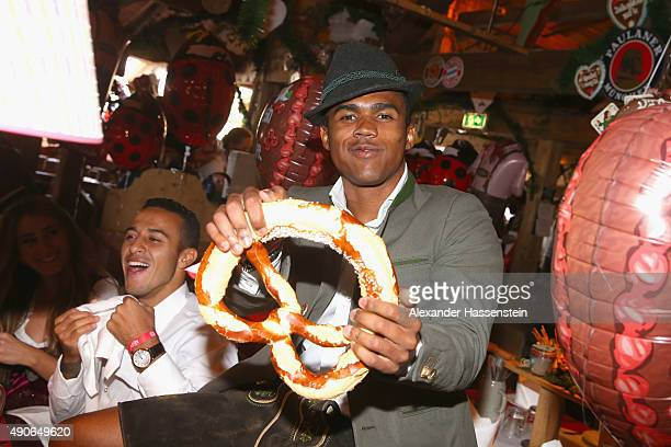 Douglas Costa of FC Bayern Muenchen attends the Oktoberfest 2015 Beerfestival at Kaefer Wiesenschaenke at Theresienwiese on September 30 2015 in...