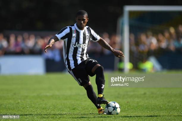 Douglas Costa of Juventus A in action during the preseason friendly match between Juventus A and Juventus B on August 17 2017 in Villar Perosa Italy
