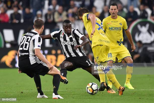 Douglas Costa of Juventus and Sergio Pellissier of Chievo Verona compete for the ball during the Serie A match between Juventus and AC Chievo Verona...