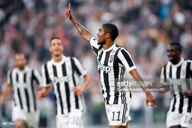 Douglas Costa of Juventus celebrates his first goal during the Serie A match between Juventus and SS Lazio on October 14 2017 in Turin Italy
