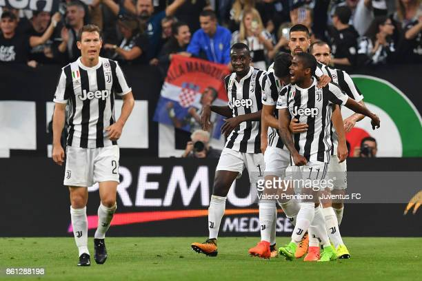 Douglas Costa of Juventus celebrates with teammates after scoring during the Serie A match between Juventus and SS Lazio on October 14 2017 in Turin...