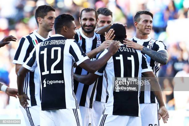Douglas Costa of Juventus celebrates with teammates after scoring the game winning penalty kick against Roma during the International Champions Cup...