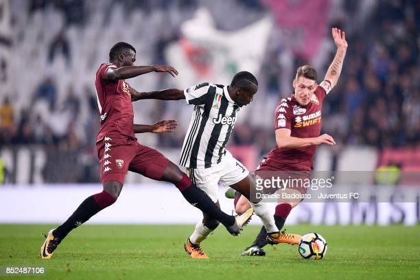 Douglas Costa of Juventus competes for the ball between M'Baye Niang and Andrea Belotti of Torino during the Serie A match between Juventus and...