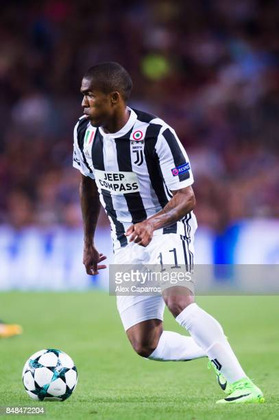 Douglas Costa of Juventus conducts the ball during the UEFA Champions League group D match between FC Barcelona and Juventus at Camp Nou on September...