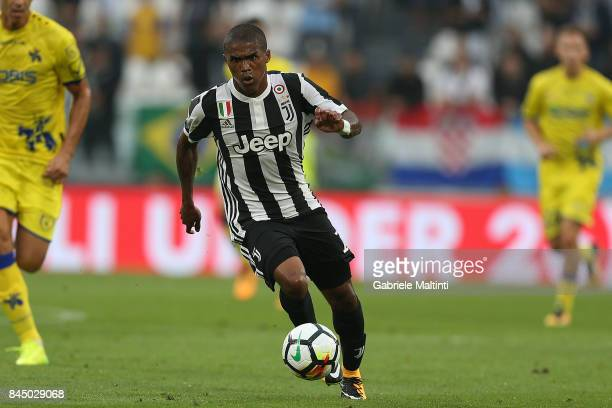 Douglas Costa of Juventus FC in action during the Serie A match between Juventus and AC Chievo Verona on September 9 2017 in Turin Italy