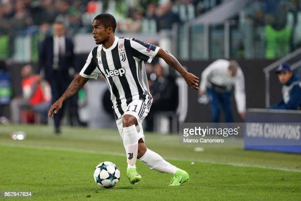 Douglas Costa of Juventus FC in action during the UEFA Champions League group D match between Juventus FC and Sporting Clube de Portugal Juventus Fc...