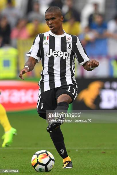 Douglas Costa of Juventus in action during the Serie A match between Juventus and AC Chievo Verona on September 9 2017 in Turin Italy