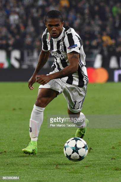 Douglas Costa of Juventus in action during the UEFA Champions League group D match between Juventus and Sporting CP at Juventus Stadium on October 18...