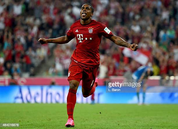Douglas Costa of Muenchen celebrates after scoring his teams last goal during the Bundesliga match between FC Bayern Muenchen and Hamburger SV at...