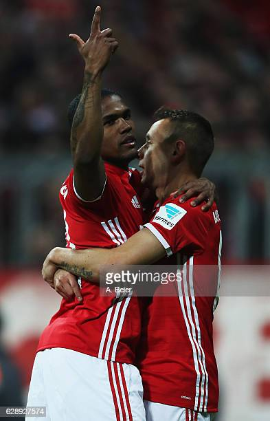Douglas Costa of Muenchen celebrates scoring the fifth goal with Rafinha during the Bundesliga match between Bayern Muenchen and VfL Wolfsburg at...