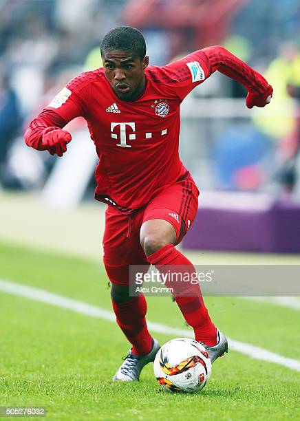 Douglas Costa of Muenchen controles the ball during a friendly match between Karlsruher SC and FC Bayern Muenchen at Wildpark Stadium on January 16...