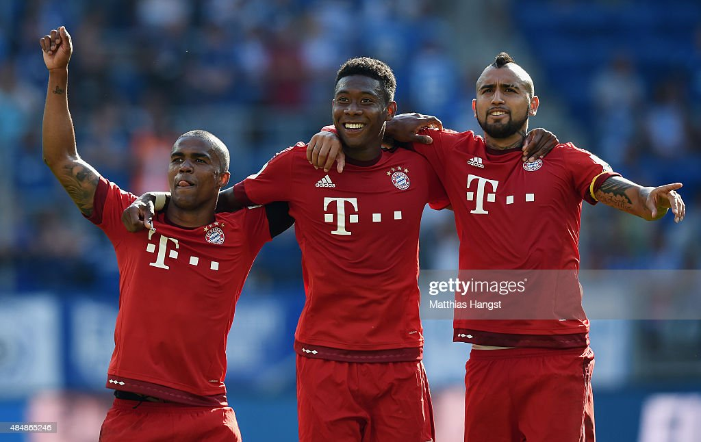 <a gi-track='captionPersonalityLinkClicked' href=/galleries/search?phrase=Douglas+Costa+-+Soccer+Forward+born+1990&family=editorial&specificpeople=5672410 ng-click='$event.stopPropagation()'>Douglas Costa</a> of Muenchen, <a gi-track='captionPersonalityLinkClicked' href=/galleries/search?phrase=David+Alaba&family=editorial&specificpeople=5494608 ng-click='$event.stopPropagation()'>David Alaba</a> of Muenchen and <a gi-track='captionPersonalityLinkClicked' href=/galleries/search?phrase=Arturo+Vidal&family=editorial&specificpeople=2223374 ng-click='$event.stopPropagation()'>Arturo Vidal</a> of Muenchen celebrate after the Bundesliga match between 1899 Hoffenheim and FC Bayern Muenchen at Wirsol Rhein-Neckar-Arena on August 22, 2015 in Sinsheim, Germany.