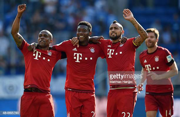 Douglas Costa of Muenchen David Alaba of Muenchen and Arturo Vidal of Muenchen celebrate after the Bundesliga match between 1899 Hoffenheim and FC...