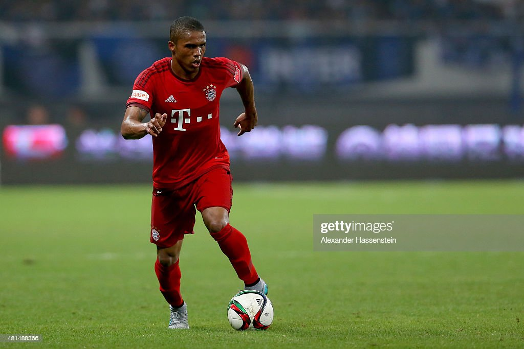 Douglas Costa of Muenchen runs with the ball during the international friendly match between FC Bayern Muenchen and Inter Milan of the Audi Football...
